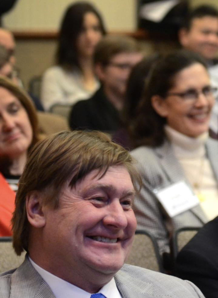 A shot of NACDD members smiling at a conference