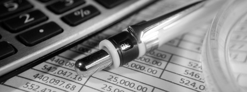 A closeup of a clickable pen above financial spreadsheets.