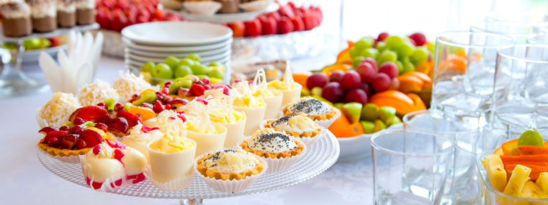 Beautifully decorated buffet spread of fruit and hors d'oeuvres